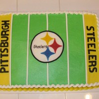 Steelers Birthday Cake One layer chocolate cake with bc frosting and fondant logo.