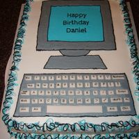 Computer The cake is all buttercream except for the keys on the keyboard. They are made of fondant. I wrote the letter and words on the keys using a...