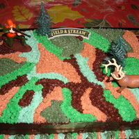 Hunter/deer/camouflage Cake My 1st camouflage cake. Easy! Customer was very pleased!!! I actually did it freehand and purchased the cake toppers at a local cake supply...