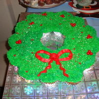 Christmas Wreath Cupcake Cake My 1st attempt at a Cupcake Cake. It was easy. I entered it in our Annual Cookie Exchange Party. Everyone loved it!!! I used 9 cupcakes in...