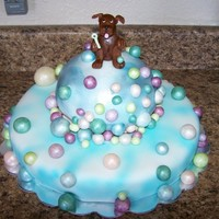 Riding A Bubble   Fondant puppy is blowing bubbles. He decided to ride one, For my nephew's first birthday.