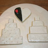 Wedding Cookies These are basic sugar cookies with fondant icing.