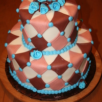 Brown And Blue Diamond This cake was created to match the theme of a baby boy's room.