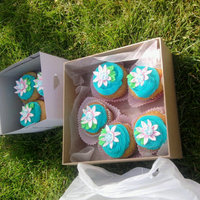 For My Daughters Girls On The Run funfetti cupcakes with BC frosting, fondant/RI/ pearl flowers.. the girls loved them after their 5k run this morning
