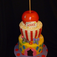"Circus B-Day 10"" chocolate cake base, 8""/8""/7"" carved vanilla middle tier and vanilla sports ball pan top."