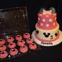 "Minnie Mouse 8 and 6"" vanilla cake with chocolate filling and vanilla buttercream. Fondant decor. Matching cupcakes!"