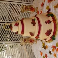 Fall Wedding Red Velvet under ivory fondant and gumpaste leaves