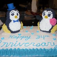 Penguin Anniversary Cake This was my first cake that I made for fun (and not just for class)! My parents love penguins so I made this for their 34th anniversary!
