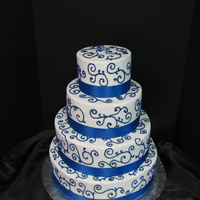 Abby's Sapphire Blue All BC with purchased sapphire blue ribbon trim. This cake was delivered the night before the wedding due to the impending Oklahoma March...
