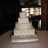 Shiny Polka Dots And Stripes Wedding Cake BC with fondant polka dots and diagonal stripes painted with pearl dust.
