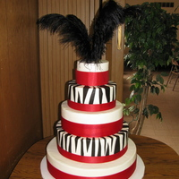 Red Zebra BC with fondant zebra stripes, purchased satin ribbon and plumes. Vanilla/Almond cake with raspberry filling. Delivered 90 miles away--no...