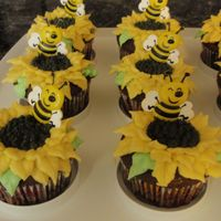 Mothers_Day_Cupcakes_003.jpg Mother's Day chocolate cupcakes, with creme' filling and buttercream sunflower on top. Decorative cupcake bee inserted. First...