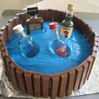 Barrel Of Booze Im new to the cake world. This cake was made last minute for my roommates 21st birthday. I tried sugar ice cubes for the first time, they...
