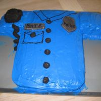 Cop Uniform I made this for my boyfriend for his graduation from the police academy. The badge, buttons, name tag and walkie talkie are made out of gum...