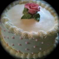 Simple Rose Strawberry cake with strawberry cream filling and vanilla BC. Both the cake and the filling recipe were gotten here on CC. Rave reviews!!!...