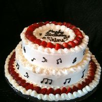 Strawberry Flavored Tune:) I was asked to do a strawberry cake with real strawberries... oh yeah and music notes.