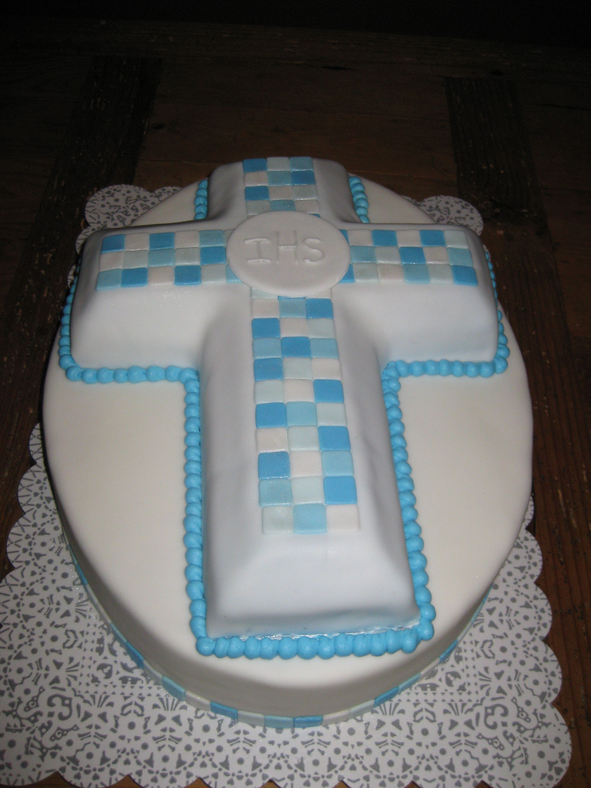Cross Cake decorated with fondant. Blue tiles accented with shimmer dust. Made for First Holy Communion.