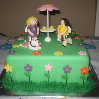 Tea Party Cake covered and decorated with fondant. Cat and dog made to match birthday girls favorite animal.