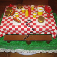 Picnic Table This cake was made for a BBQ engagement party. All decoration is made of fondant. Ants are carrying replica of the engagement ring.