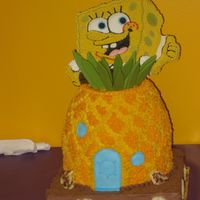 Spongebob Pineapple made of cake - covered with buttercream. Spongebob made of candy melts - decorated with royal icing.