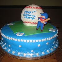 "Baseball Cake 14"" cake covered and decorated with fondant. Baseball cake covered with buttercream. Figurine made of fondant - copied from party..."