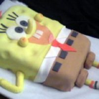 Spongebob Cake This was a one-layer 9 x 11 chocolate cake, carved to shape, torted and filled with chocolate buttercream...fondant covering and accents.