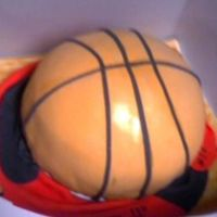 Basketball Cake The basketball cake was carved from 3 9-inch layers and covered in fondant and fondant accents. The board underneath is painted with brown/...