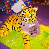 "Lsu Tiger Cake  I made this cake for my dad's 60th birthday - he's a HUGE LSU football fan. The body was hand carved from 2 16"" square..."