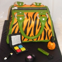 Zebra Purse Cake  This was my first purse cake! I loved doing it since its so girly. Made to match the bday girls favorite colors orange/green. She chose...