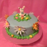 Easter Cake  This was a quick and cute Easter cake I made for my neighbors. The bunny is hand done out of MMF and gumpaste. The eggs and flowers are MMF...