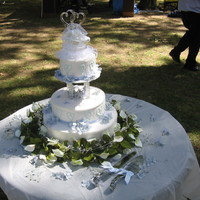 Summer Wedding Three teir cake, whipped cream frosting, with beading ribbon and beading decor. Silk flowers on cake and around the base. Was fun to do,...