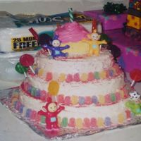 Teletubbies 1 Yr. Old Birthday Cake Decorated with gumdrops, lollipops and a giant cupcake on top which was decorated with icing.