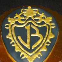 Jonas Brothers Cookie No fail sugar cookie, royal icing. Americolor gold airbrush color.