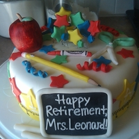 Teacher Retirement Made for a teacher who was retiring from a local school. Cake was WV(vanilla)SC cake with chocolate ganache. The apple is RKT with fondant...