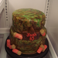 Hunting Hunting cake. Hand painted camo on white marshmallow fondant. Shot guns shells(not my best) krispy bars rolled and covered.