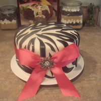 Zebra Print Marshmallow fondant with a real bow.