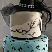 Top Hat And Feathers This cake was made for the grand opening of a local spa. Lemon sour cream cake underneath w/ white chocolate BC and fondant on top. The...