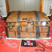 Treasure Chest My first time making a cake this large. It was 3 stacked half sheets and the top is rice crispy treats