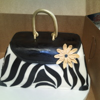 Purse Class Cake Zebra pattern purse cake with fondant flower. Made this in a class at a local cake shop.