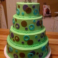 Green Wedding Cake buttercream icing, fondant circle cut outs