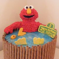 Elmo Takes A Swim. Customer gave me the choice of Elmo or Barney for a 2yo birthday. I chose Elmo and wanted to do something different. 10 inch triple layer...