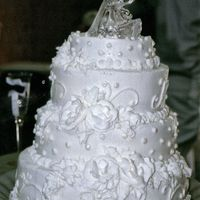 First Wedding Cake I've decorated cakes off and on for 25 years, working at various grocery stores, and Baskin Robbins. This was the first wedding cake I...