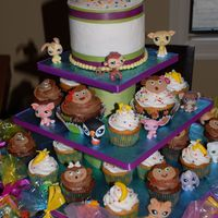 Littlest Pet Shop the birthday girl wanted some monkeys, so i made this cupcake tower and cutting cake for her with fondant monkeys and banannas.