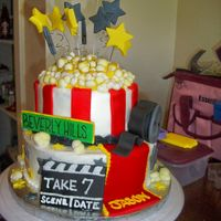 "The Hollywood Cake Here is the Hollywood cake I made for a birthday.... the top 'popcorn' is hand rolled fondant with buttercream 'Butter""..."