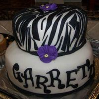Garrettcake3.jpg This was an orange flavored cake and a chocolate cake baked in a layered zebra pattern with a white chocolate and orange truffle filling...