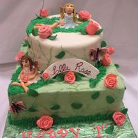 Fairy And Roses Cake this was a 2 tiered first birthday cake with a roses and fairies theme...The roses as well as the fairies and butterflies were all made...