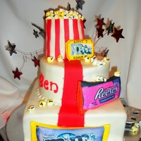 A Day At The Movies Movie theatre cake...popcorn box is RKT filled with marshmallows cut, painted and airbrushed to look like popcorn, candy is fondant covered...