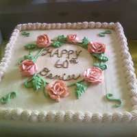 Ring Of Roses WASC cake with raspberry filling and Extra Special Buttercream frosting. It was a 2 layer 12x12 cake...ivory frosting, peach-colored roses...