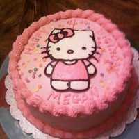 Hello Kitty Inspired by a wonderful cake here on CC...vanilla cake, raspberry filling, vanilla BC frosting. Cupcakes were the same flavors, wrappers...