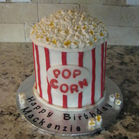 "Popcorn Bucket This cake was so fun to make. The ""popcorn"" is made from mini-marshmallows. I used several cakes on here for inspiration!"